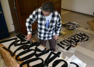 Kim Baez, of the Alumni Association helps prepare the new clock numbers for the Tamalpais Clock Tower