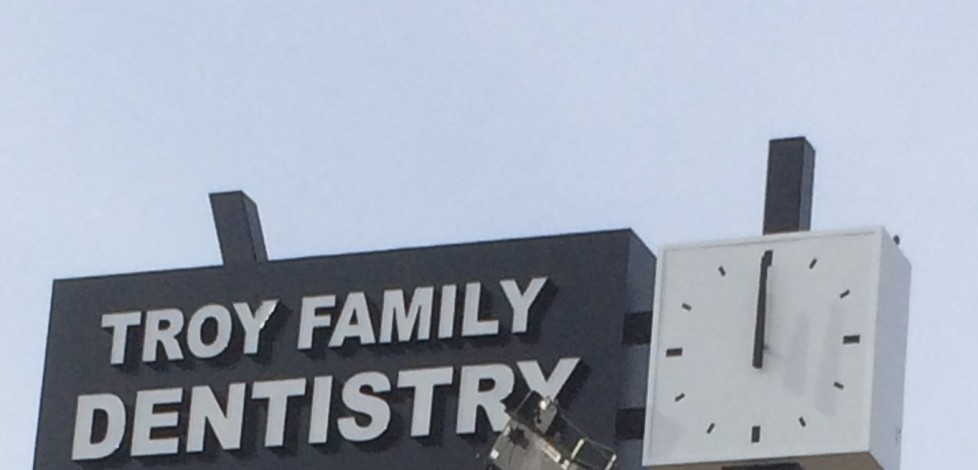 UFB Fab completes bright and shiny new sign and clock for Troy Family Dentistry